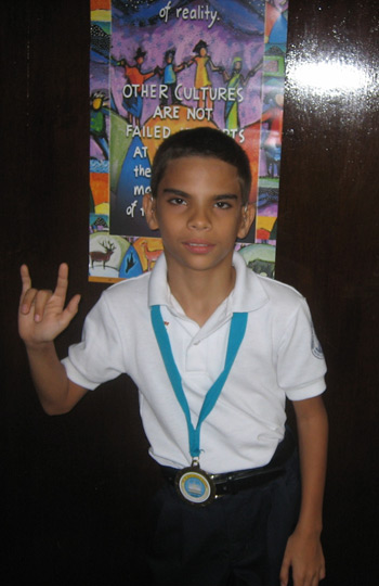 A young man showing the sign language symbol for I love you