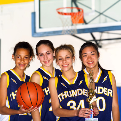 4 young women on a winning basketball team