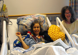 Girl in hospital bed with friend